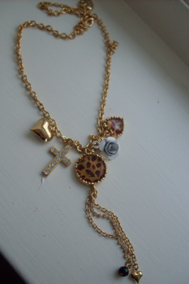 Betsey Johnson necklace leopard and cross.
