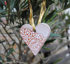 Ceramic heart for hanging with a lace pattern