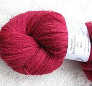 Hand dyed thin lace yarn of Blue Face Liecester red