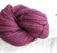 Hand dyed thin lace yarn of Blue Face Liecester redpinkblue
