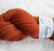 Hand dyed thin lace yarn of Blue Face Liecester orange