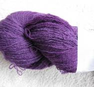 Hand dyed thin lace yarn of Blue Face Liecester purple