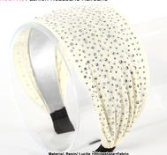 White aliceband with rhinestone.