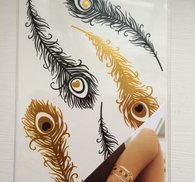 Coola fake tatueringar i guld