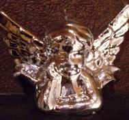Silver angel candle