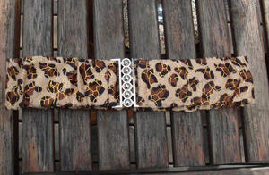 Leopard belt with gold thread.