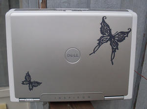 Laptop skin flower bling.