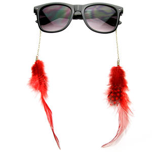 Nice sunglasses with red feathers.