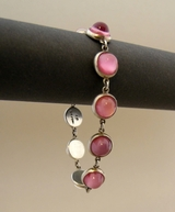 Silver bracelet, pink stones