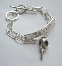 Bracelet with raven skull