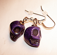 Skull earrings deep purple