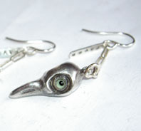 Earring raven skull green eyes
