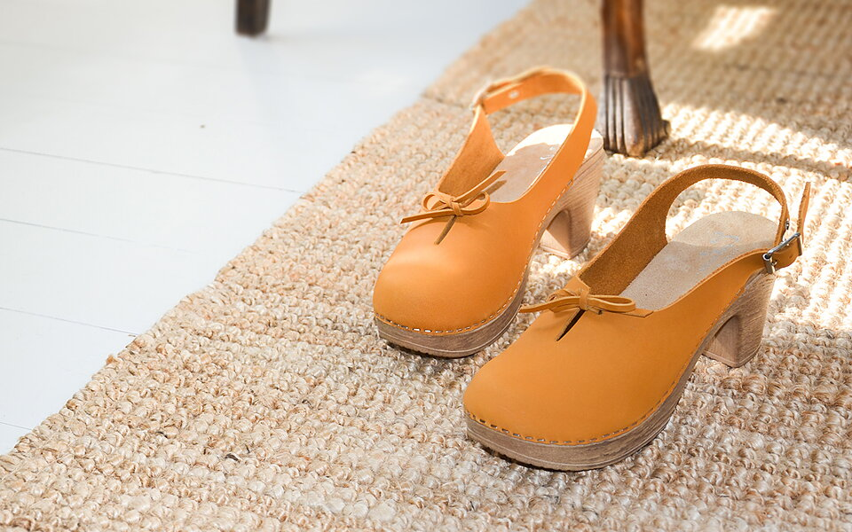 Our clogs feature a cushioned polyurethan sole which makes them lighter and  more comtortable than a traditional wooden-soled clog. a4e4a92460