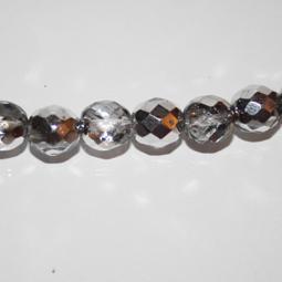 Fasetter i crystal och silver, 10 mm. Ca 12 cm sträng.