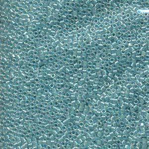 Delica 11/0,  lined aqua blå AB. 5 gram.
