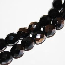 Svarta fasetterade glaspärlor med delvis kopparcoating, 8 mm.