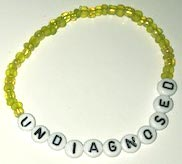 UNDIAGNOSED Bracelets yellow/white