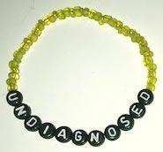 UNDIAGNOSED Armband gult med svart