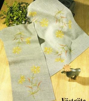 Duk med gula blommor