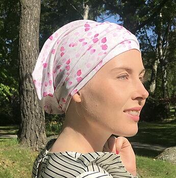 aBonnetta rosa vid håravfall