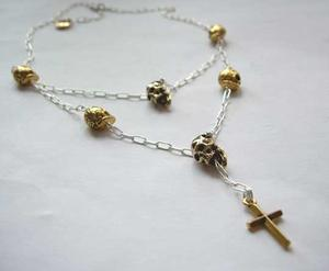 Skull necklace in silver and gold