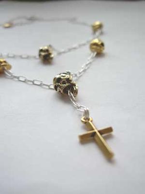 Dödskalle halsband i silver och guld