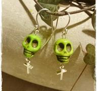 Skull earrings green