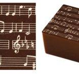 Överföringsark  Symphonie, vita noter på mörk chokladbotten.