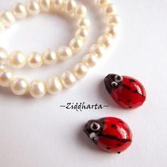 LampWork: Handgjord glaspärla: Ladybug - Nyckelpiga 15x10mm