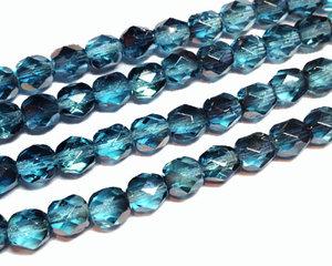 Fasetterade svagt blåturkosa pärlor med guldlyster, 6 mm. En sträng.