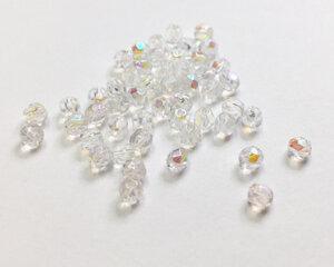 Fasetterade firepolish, Crystal AB, 3 mm. 50 st