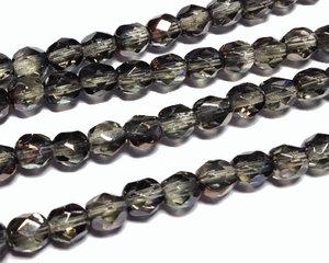 Fasetterade pärlor i crystal smoke med guldlyster, 5 mm. En sträng.
