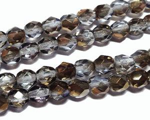 Fasetterade pärlor i crystal grå med guldlyster, 6 mm. En sträng.