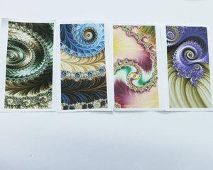Bilder till rektangulära glascabochoner, 50*25 mm. Paisleyinspirerat mönster, 2 stycken.