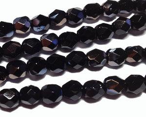 Fasetterade svarta pärlor med guldlyster, 6 mm. En sträng.