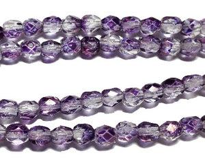 Fasetterade crystal lila pärlor, 4 mm. En sträng.