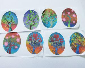Bilder till ovala glascabochoner, 30*23 mm. Livets träd, 4 stycken.