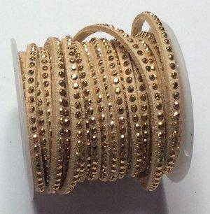 Syntetisk mocka med en rad guldbling, 5 mm bredd. Per 20 cm