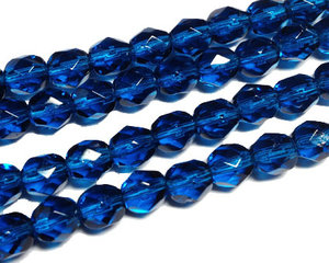 Fasetterade blå pärlor, 6 mm. En sträng.