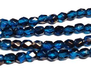 Fasetterade blå pärlor med guldlyster, 4 mm. En sträng.