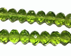 Äppelgrön fasetterad donutpärla, 7*10 mm. En 12 cm sträng.