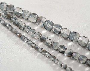 Fasetterade firepolish, Crystal Valentinite, 6 mm. En sträng.