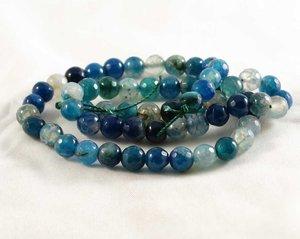 Fasetterade blå agater, 6 mm. En sträng ca 38 cm.