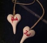 Vita hjärtan på kort-snöre med God Jul