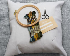 Starter-kit including  aida pillow case, floss, needle, notions and gift card