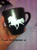 Stoneware mug with Icelandic design.