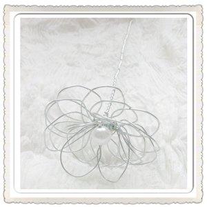 Blomma på pinne
