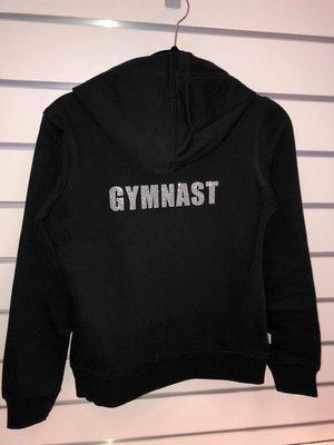 """Texten """"Gymnast"""" i glittertryck"""