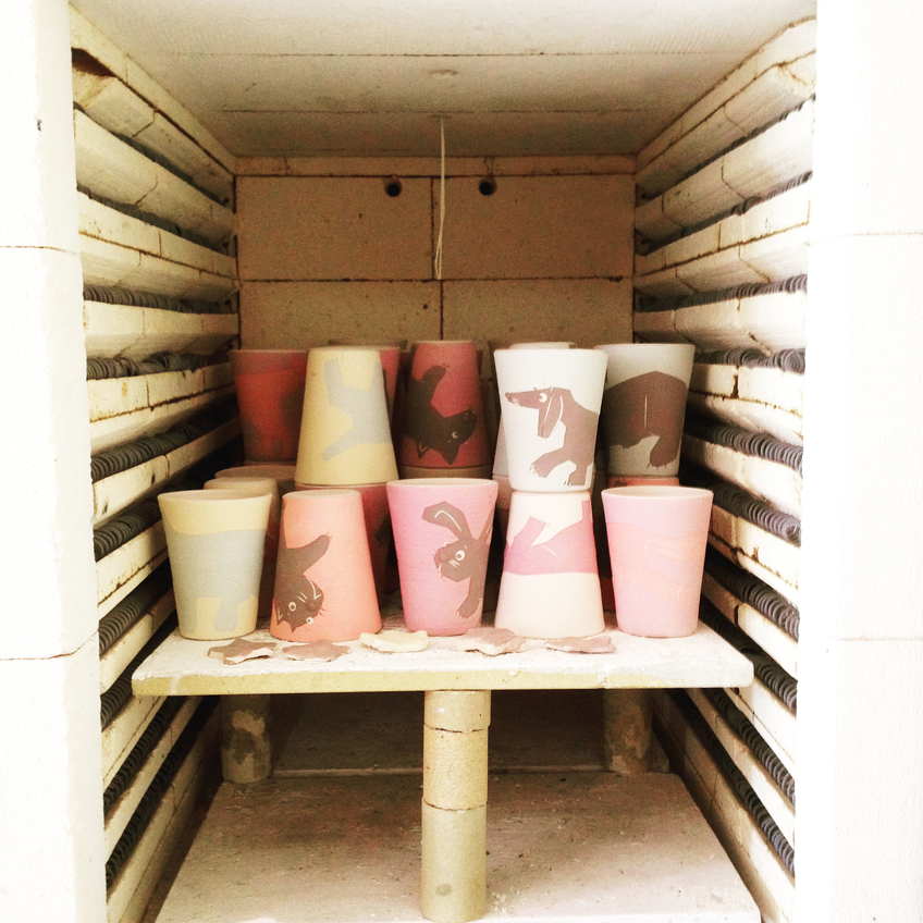Mutmugs going into the kiln for a first birning, without glace.