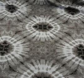 ljus botten batikcirklar i beige toner